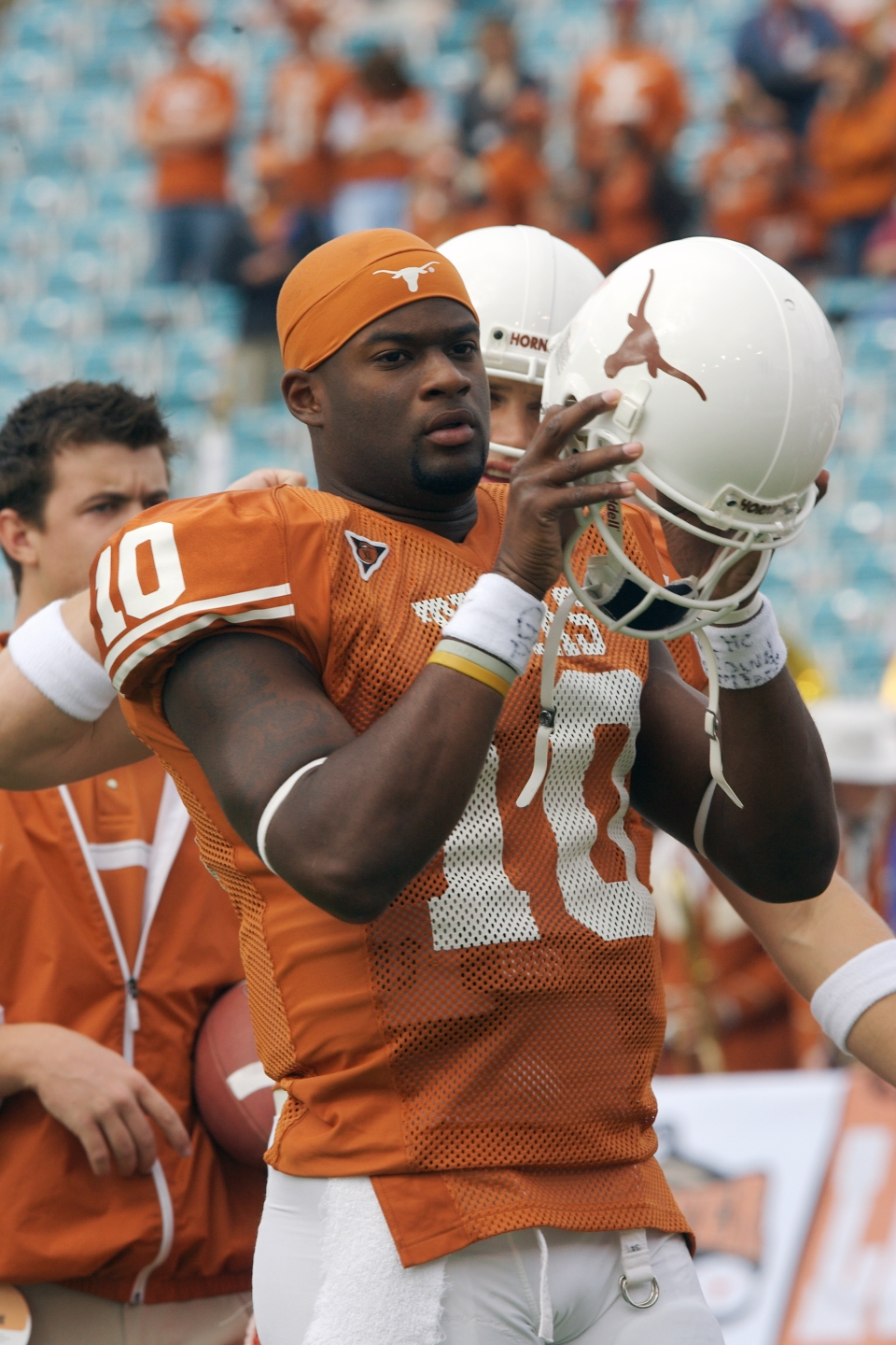 Vince Young Putting on Helmet