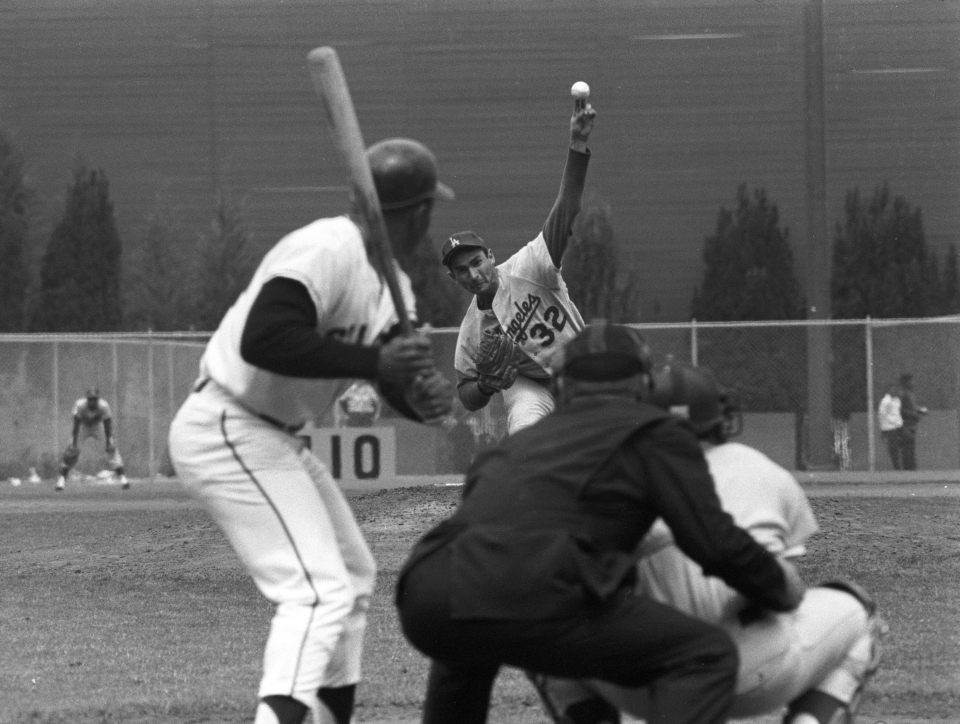 Sandy Koufax Pitching to Willie Mays